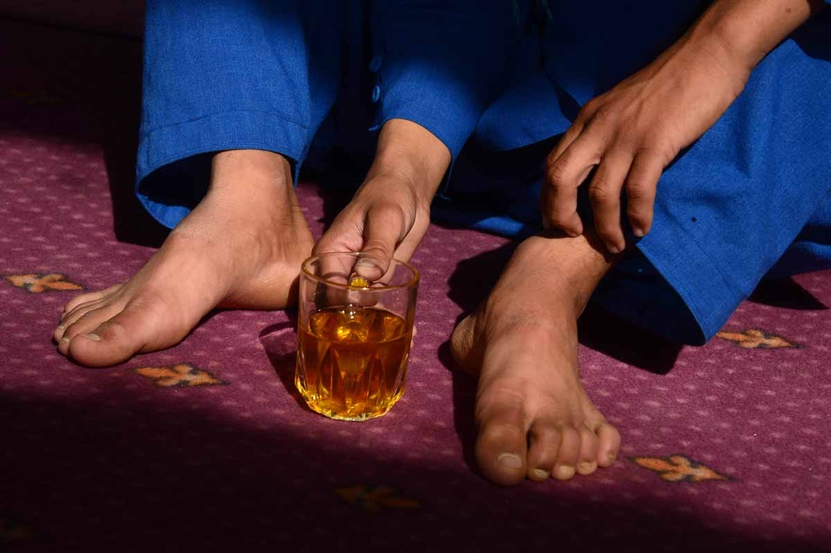 This file photo taken on October 31, 2016 shows an Afghan boy, who was held as a child sex slave, drinking tea at a restaurant in a unidentified location in Afghanistan.