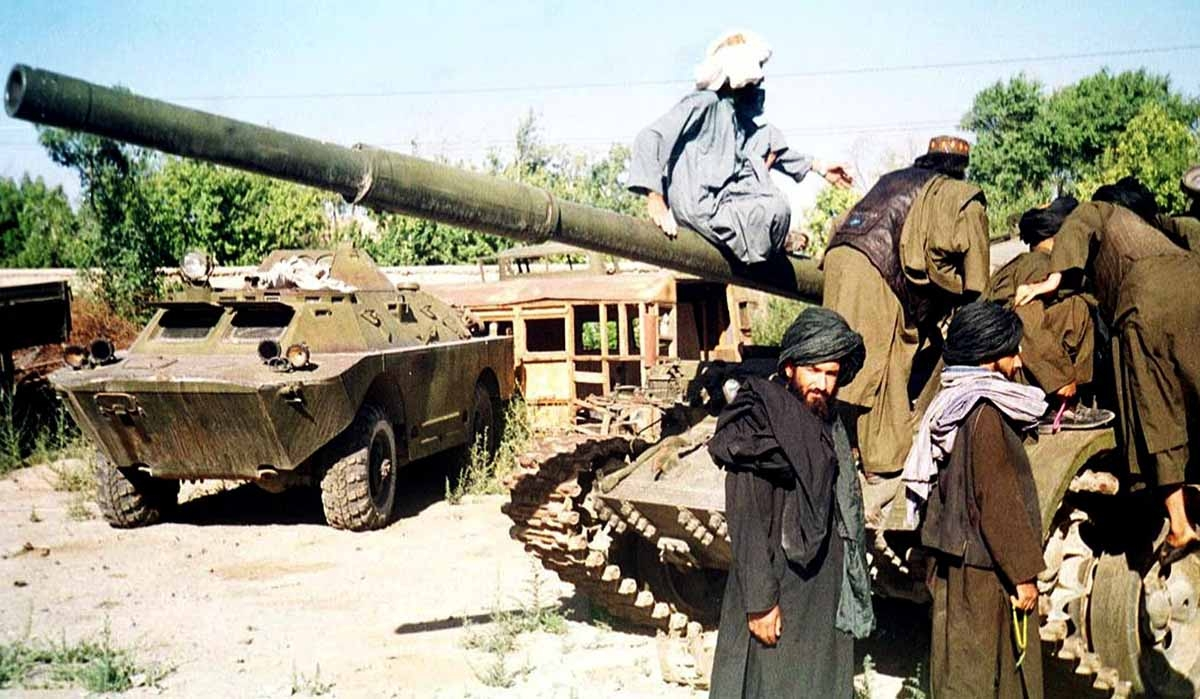 Taliban figthters Tuesday try to repair their broken military tank in the Afghan capital, Kabul, 02 October 2001.