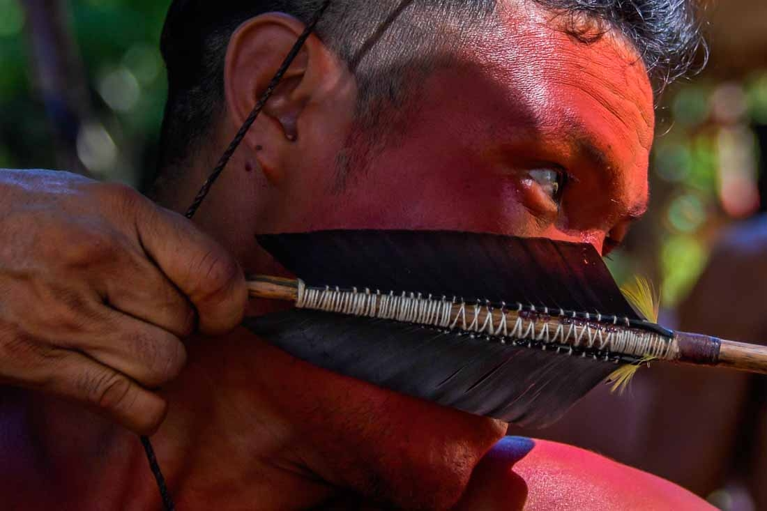 A Waiapi man uses his bow and arrow at the Pinoty village at the Waiapi indigenous reserve on Amapa state, in Brazil, on October 12, 2017.   The Waiapi are one of the most traditional tribes in Brazil's Amazon, but modern life is getting closer – and the