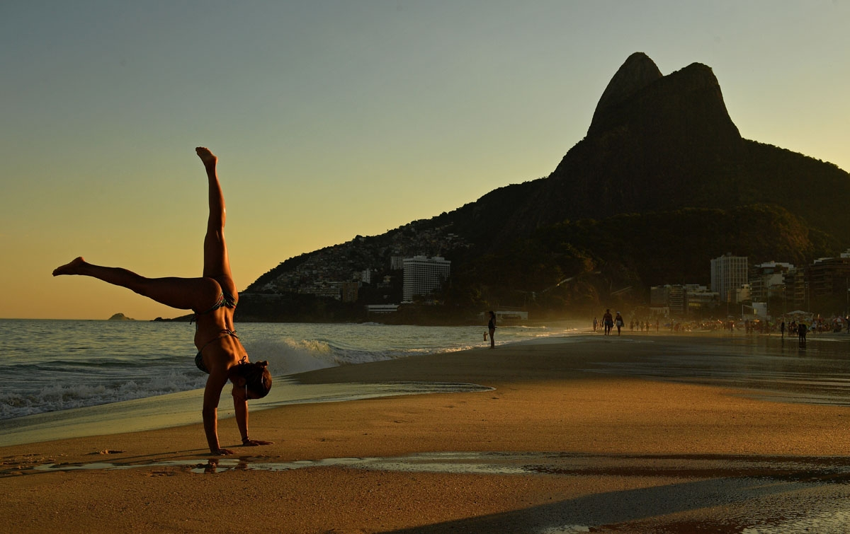 Brazilian gymnast Virginia Lins does a handstand on Ipanema Beach in Rio de Janeiro, Brazil, on June 1, 2018.