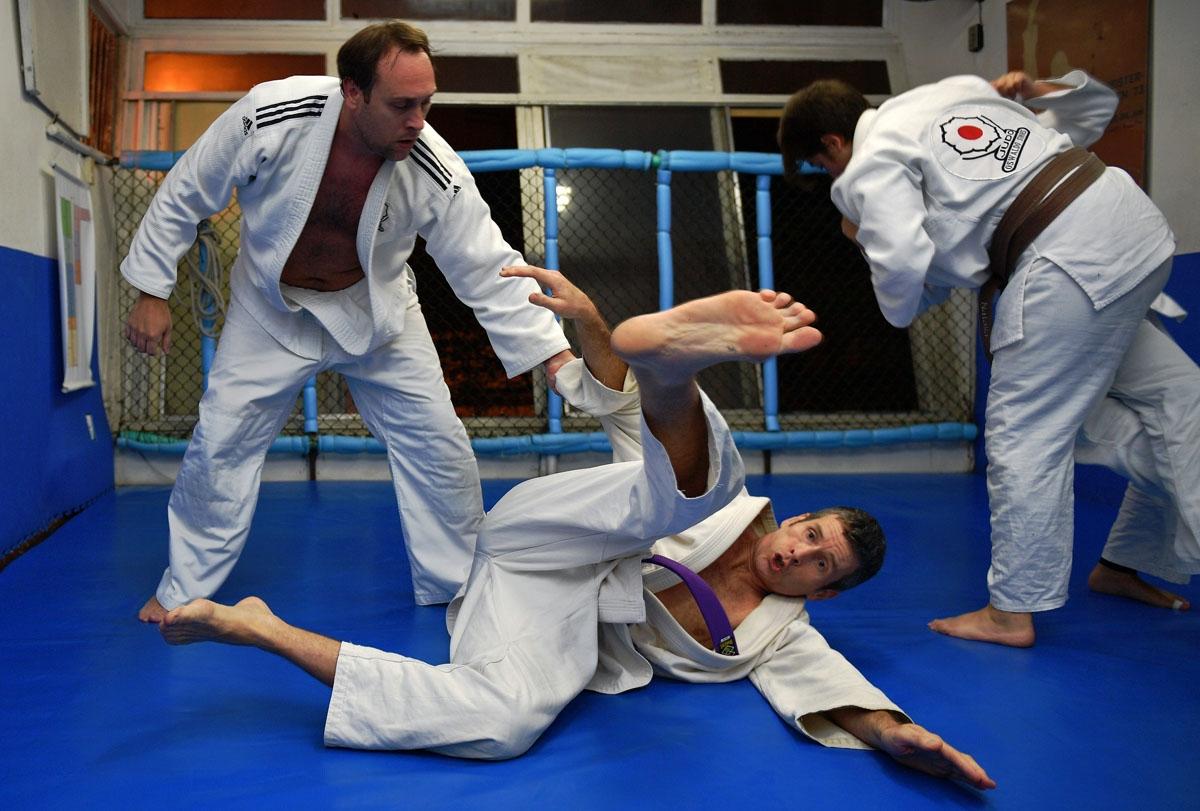 The author (on the ground) takes a tumble during his judo class in Rio de Janeiro, August 29, 2018.