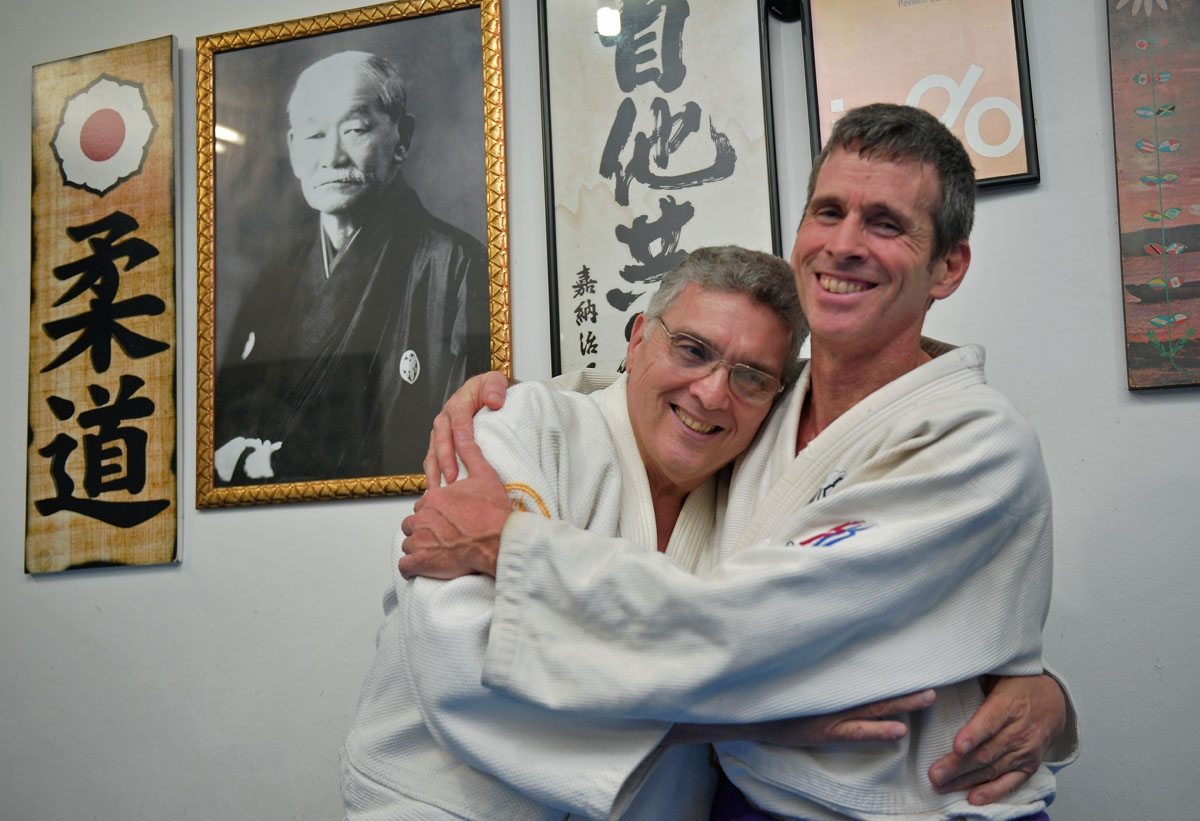 The author and his judo Sensei Oswaldo hug each other, a regular practice at the judo center.