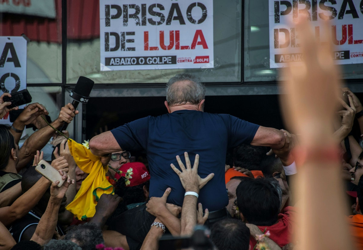 Brazilian ex-president Luiz Inacio Lula da Silva is carried by supporters after attending a Catholic Mass in memory of his late wife in Sao Bernardo do Campo, in Sao Paulo, Brazil, April 7, 2018.