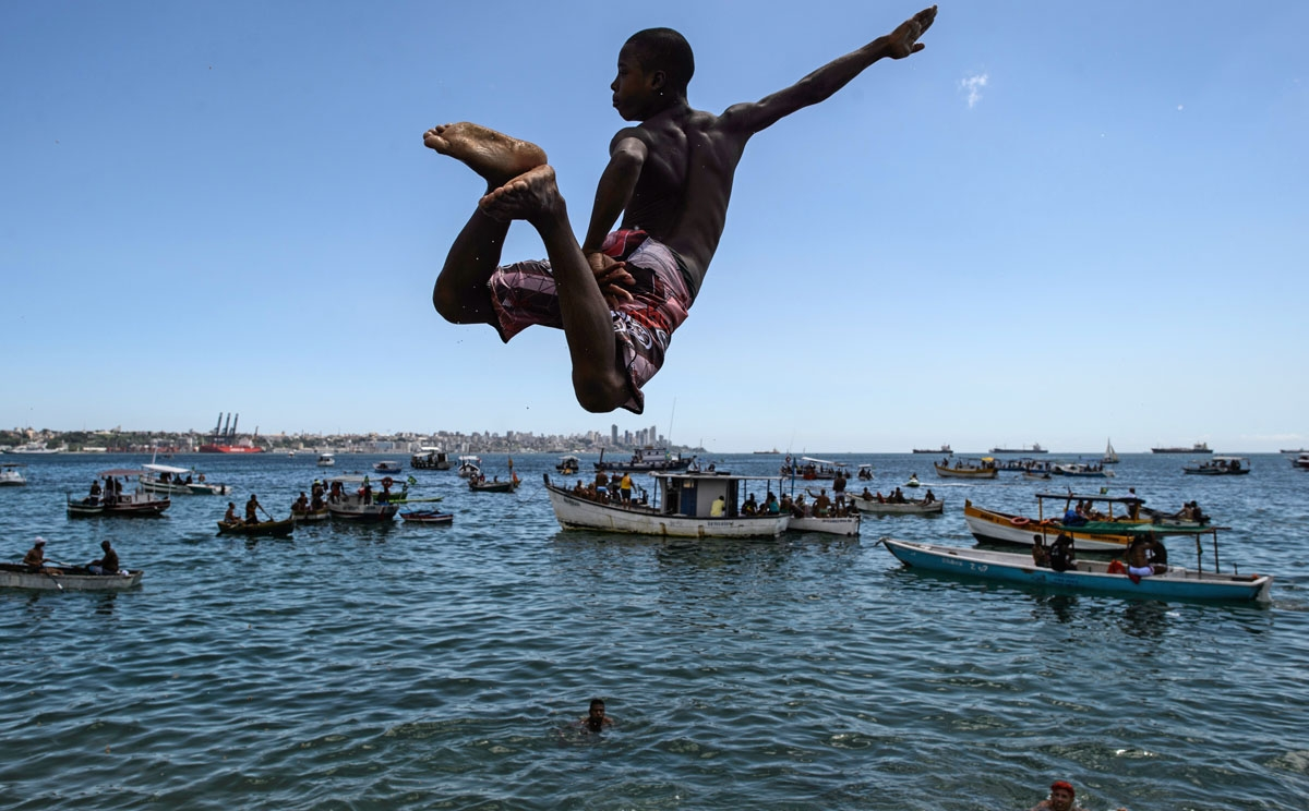 Diving in. A young man jumps into the sea at Boa Viagem beach in Salvador, Bahía, Brazil, on January 1, 2015.