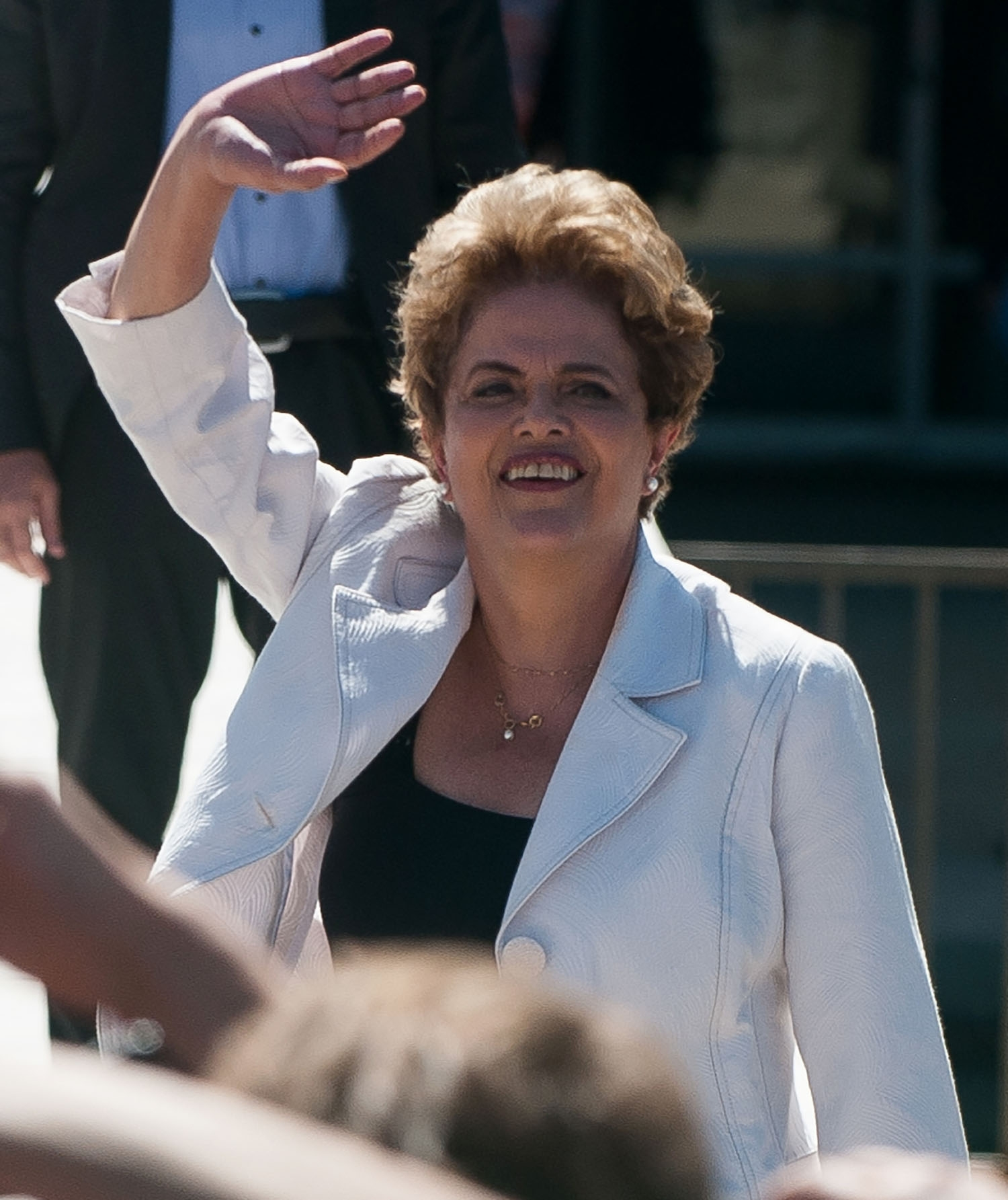Brazil's suspended President Dilma Rousseff waves to supporters as she leaves Planalto Palace in Brasilia on May 12, 2016