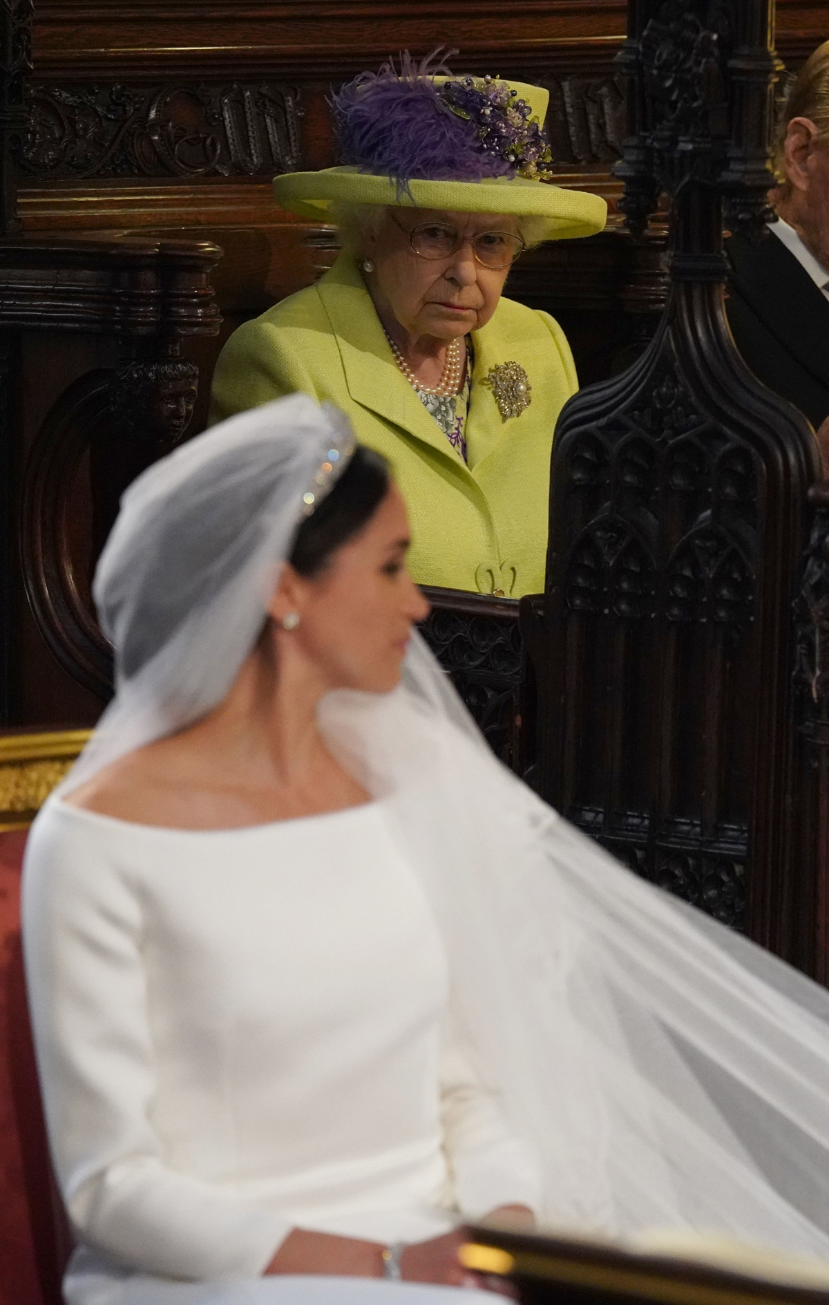 Britain's Queen Elizabeth II looks on during the wedding ceremony of Britain's Prince Harry, Duke of Sussex and US actress Meghan Markle in St George's Chapel, Windsor Castle, in Windsor, on May 19, 2018.