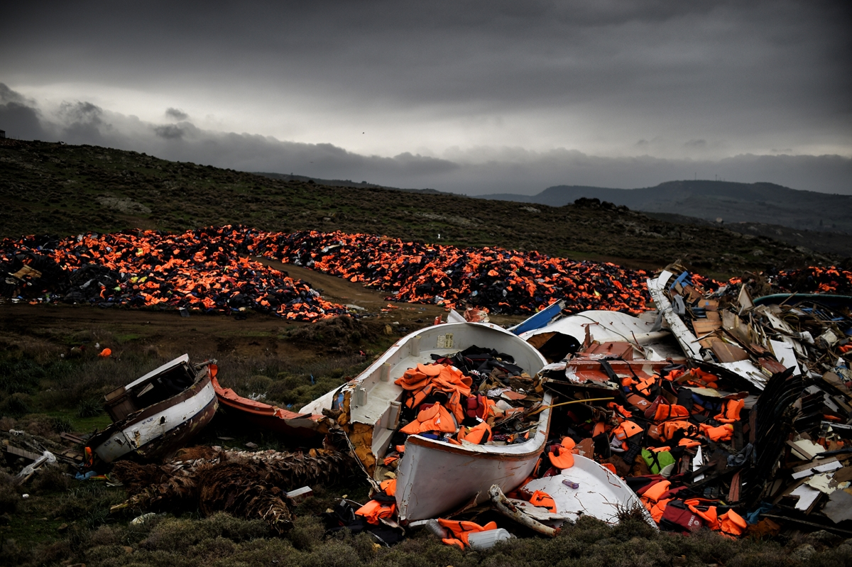 Wrecked boats and thousands of life jackets used by refugees and migrants during their journey across the Aegean sea lie in a dump in Mithimna on February 19, 2016. The EU and Turkey will hold a special summit in early March to push forward a deal to stem