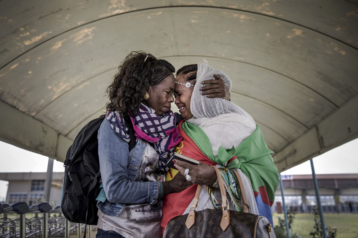 Eritrean sisters reunite after two decades at the airport in the Eritrean capital on July 19,2018, in the wake of resumption of ties between Ethiopia and Eritrea following 20 years of conflict and war that separated families and friends.