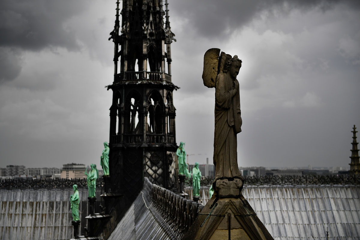 A picture taken on June 28, 2017 shows a statue on the roof of Notre-Dame cathedral in Paris, as the monument needs a huge restoration.