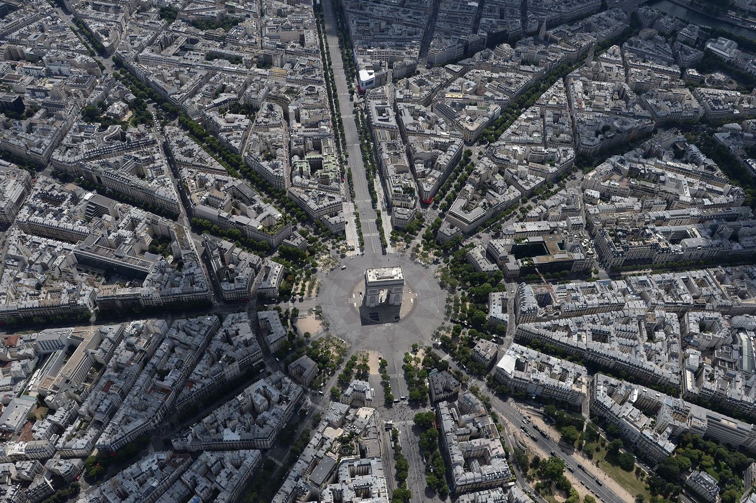 An aerial view shows the Arc de Triomphe during the annual Bastille Day military parade on the Champs-Elysees avenue in Paris on July 14, 2017. The parade on Paris's Champs-Elysees will commemorate the centenary of the US entering WWI and will feature hor