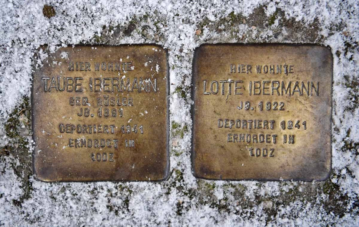 Two Stolpersteine (stumbling blocks), commemorating Holocaust victims, are pictured in front of Fehrbellinerstrasse 86 in Berlin on January 5, 2017. The small plaques the size of a child's hand state the fate of a mother and daughter who lived in a small