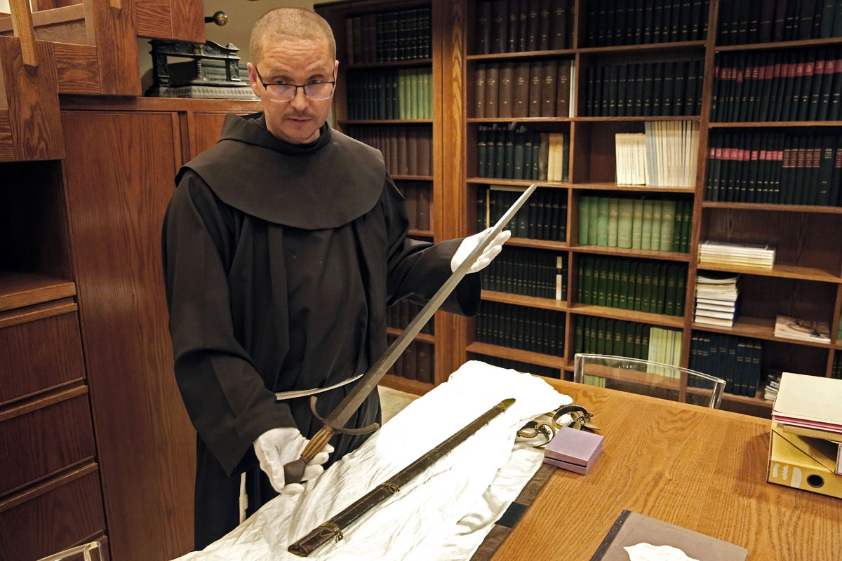 Franciscan friar Serge Loktionov shows the sword used since the XIII century by the Custos (the chiefs of the Franciscans in the Holy Land) to anoint knights of the Holy Sepulchre.