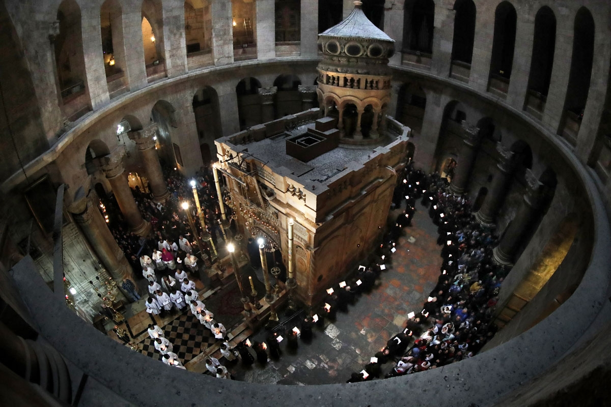 Franciscan friars pray and sing during the Lenten procession around the Tomb believed to the be site where Jesus Christ is buried in the Church of the Holy Sepulchre in the Old City of Jerusalem, on February 17, 2018.