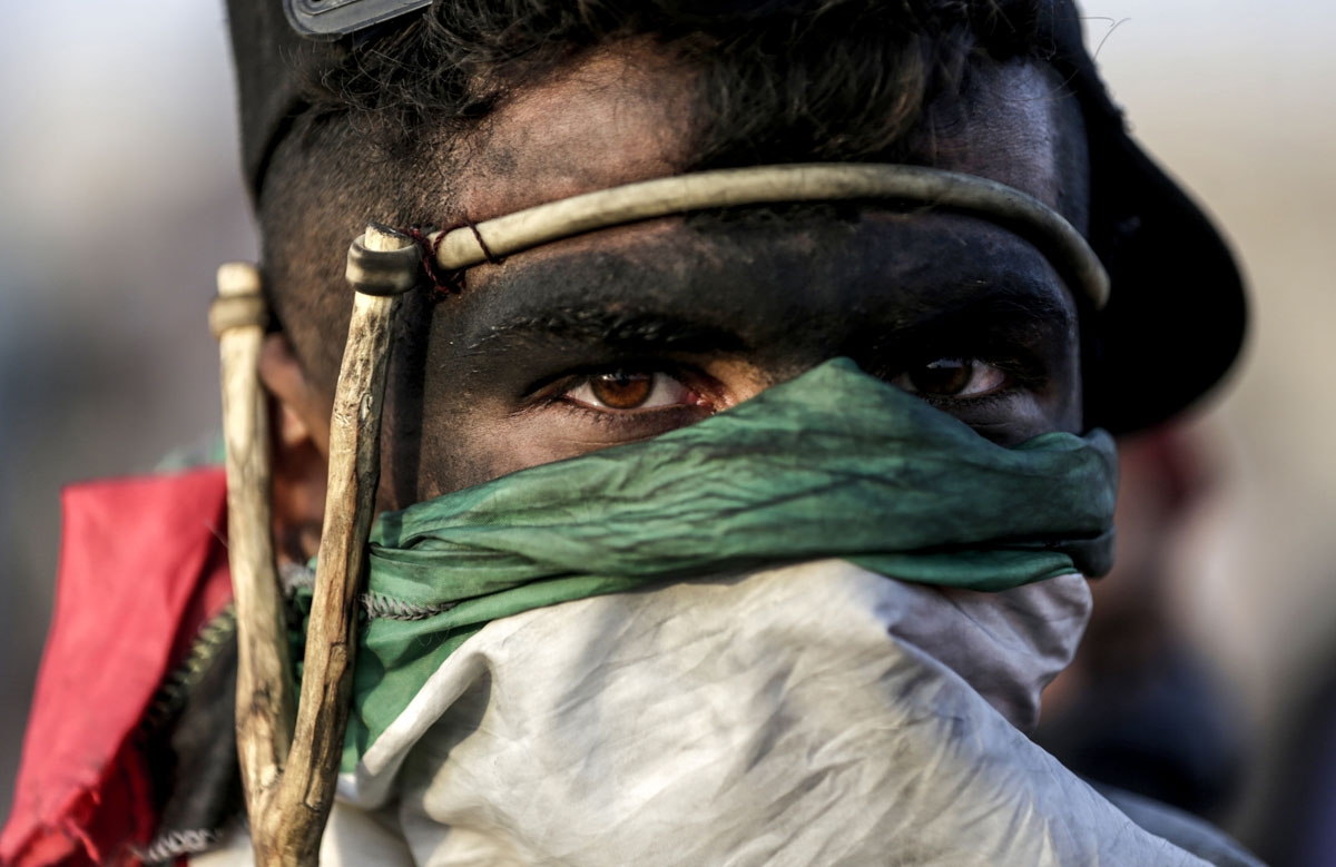 A Palestinian demonstrator looks on during clashes with Israeli forces along the border with the Gaza strip, east of Gaza City, on May 11, 2018, as Palestinians demonstrate for the right to return to their historic homeland in what is now Israel. - Over f