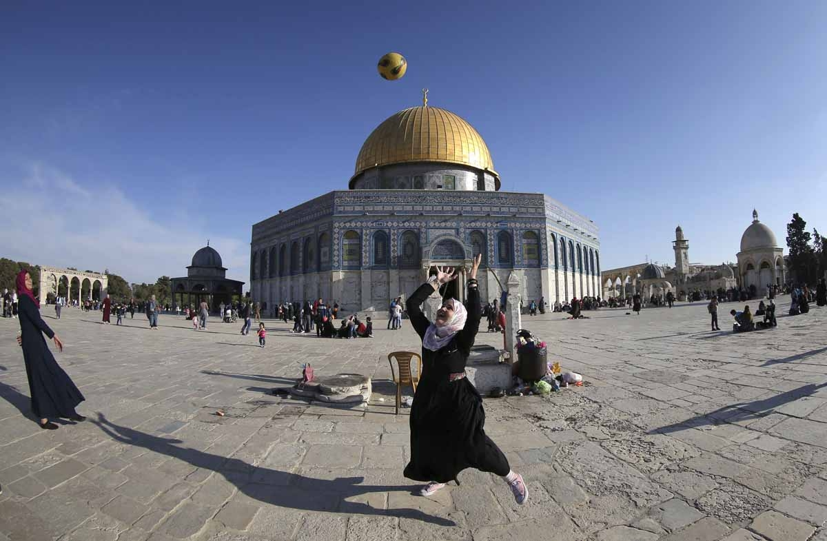 Playing football at the Al-Aqsa Mosque compound, with the Dome of the Rock in the background, April, 2017.