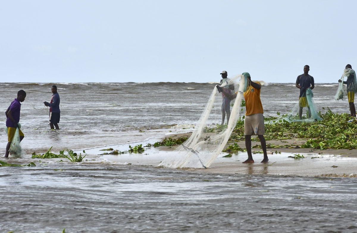Fishermen cast their nets close to the shore of Grand Lahou on November 3, 2016.