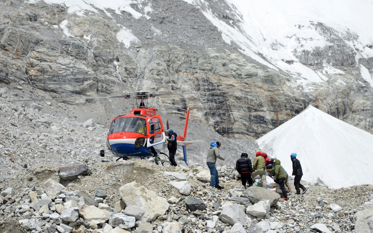 A helicopter delivers goods to Everest base camp, April 24, 2018.