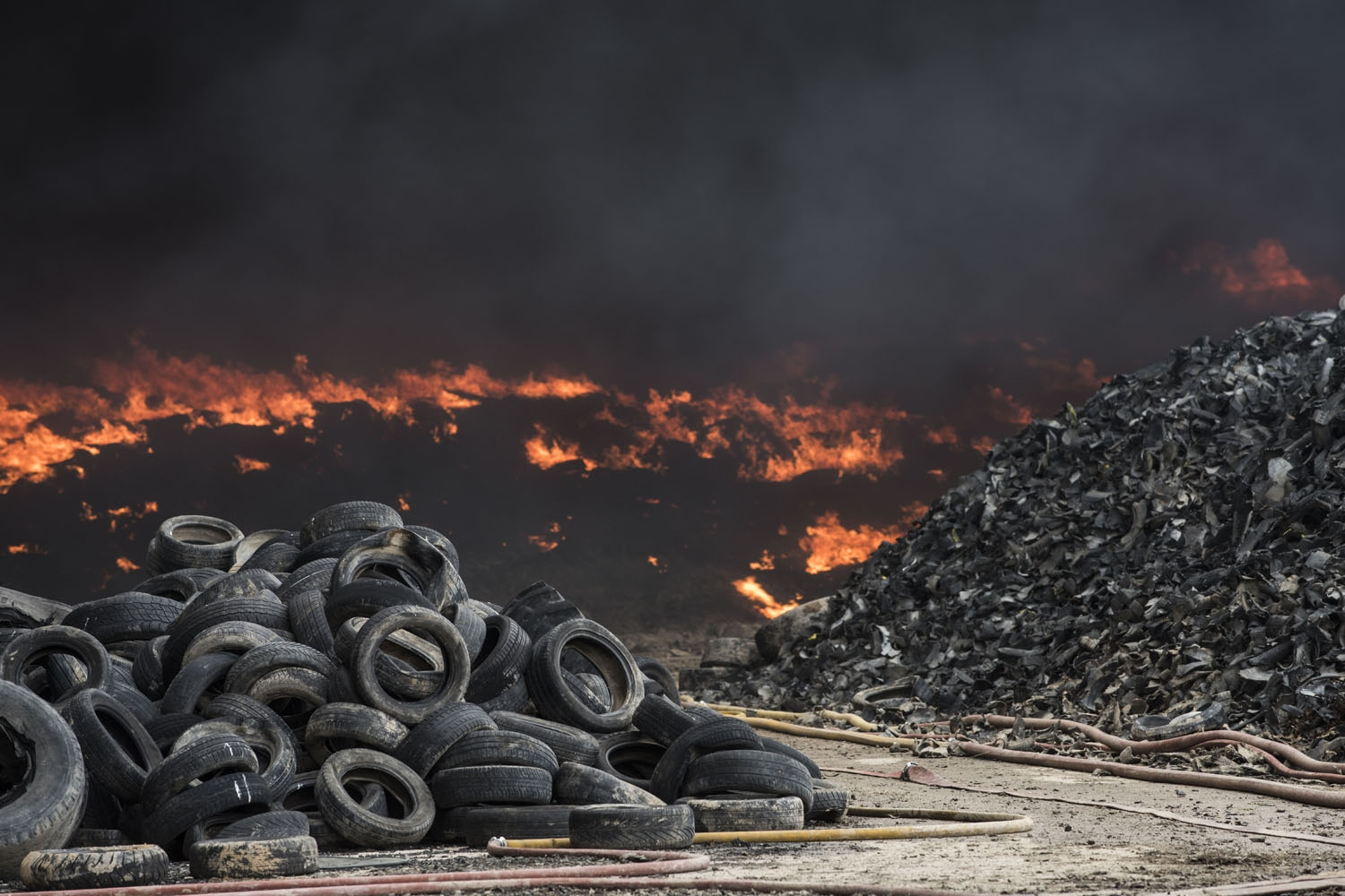 Tyres burn in an uncontrolled dump near the town of Sesena, after a fire brokeout early on May 13, 2016