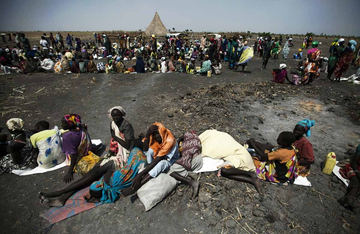 A large number of people wait for food air-drops by ICRC (International Committee of the Red Cross), outside Thonyor, in South Sudan, on February 3, 2016.