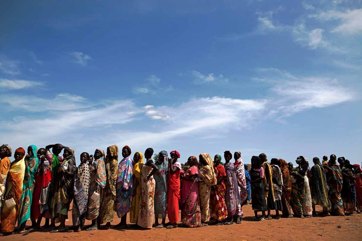 Internally displaced people (IDPs) recently arrived to Wau, South Sudan, due to armed clashes in surrounding villages, wait to be registered by the International Organization for Migration (IOM) and the World Food Programme (WFP) on May 11, 2016.