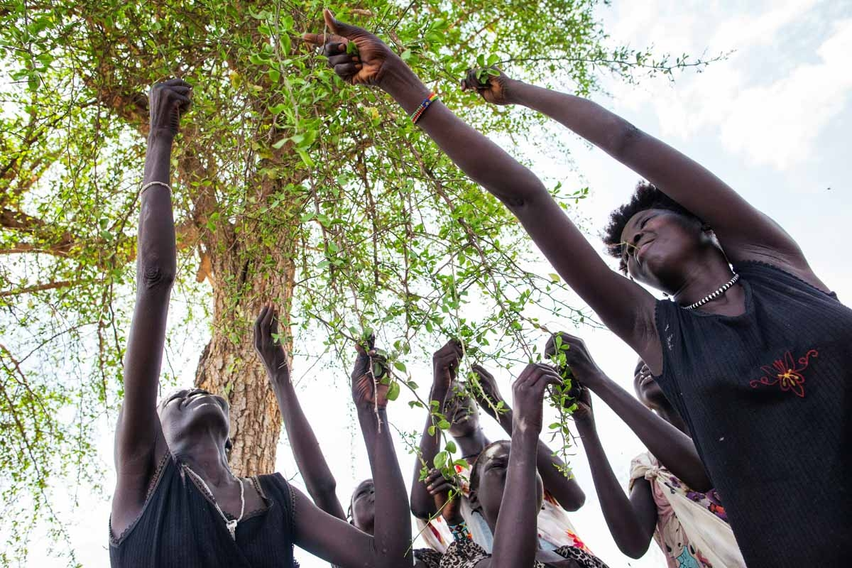 Displaced women collect leaves outside Lankien, in Jonglei State, South Sudan, on April 6, 2016.