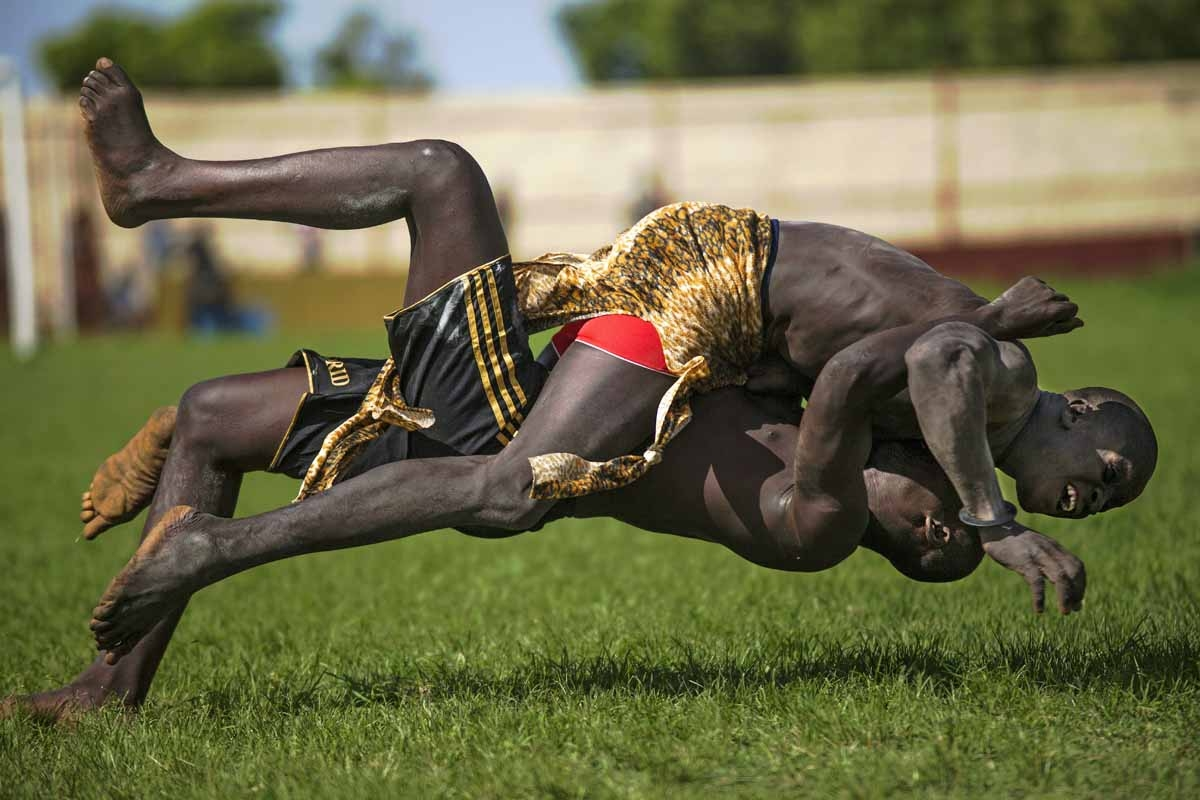 Two participants from Imatong and Terekeka counties take part of the South Sudan National Wrestling Competition for peace at Juba Stadium, on April 20, 2016.