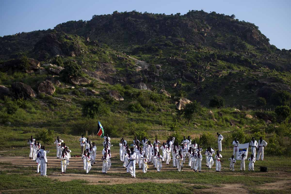 Young boys take part in their daily taekwondo training session at the Juba Jebel (mountain) on June 23, 2016.