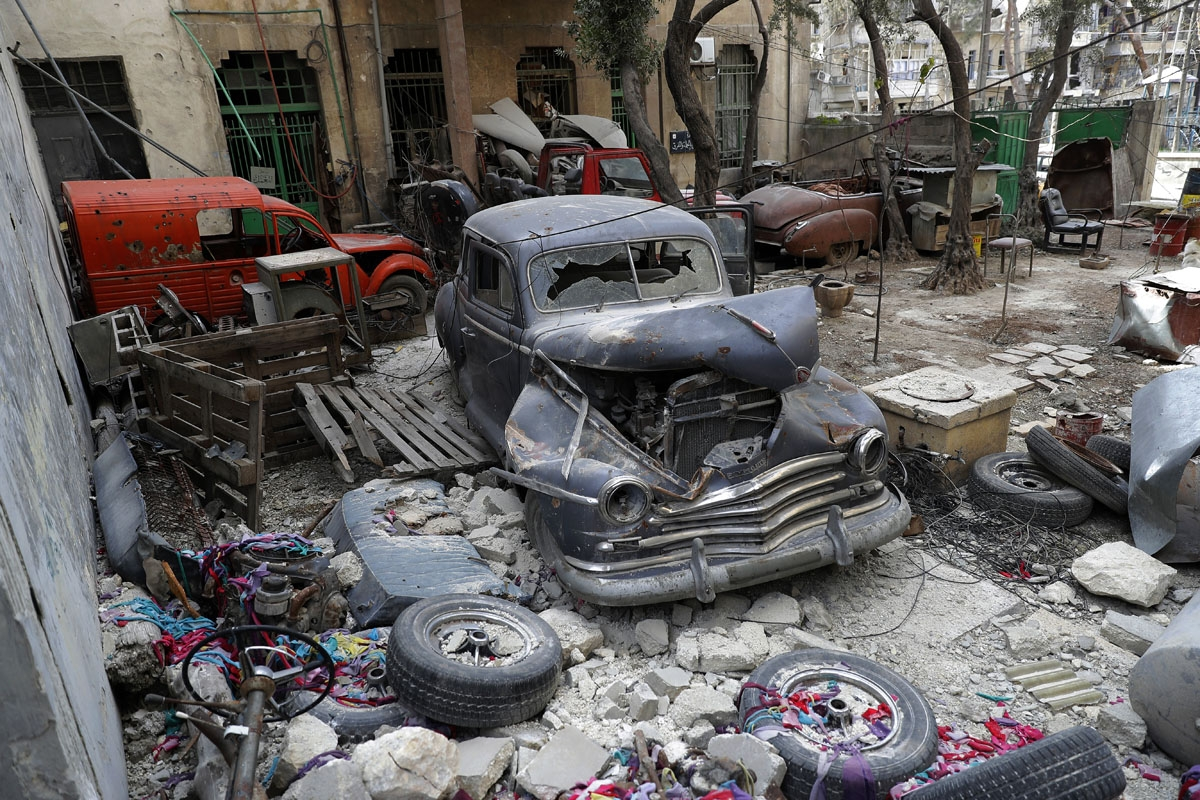 A picture taken on March 9, 2017, shows a 1947 Plymouth parked in the garden of Mohammad Mohiedine Anis' home in Aleppo's formerly rebel-held al-Shaar neighbourhood.