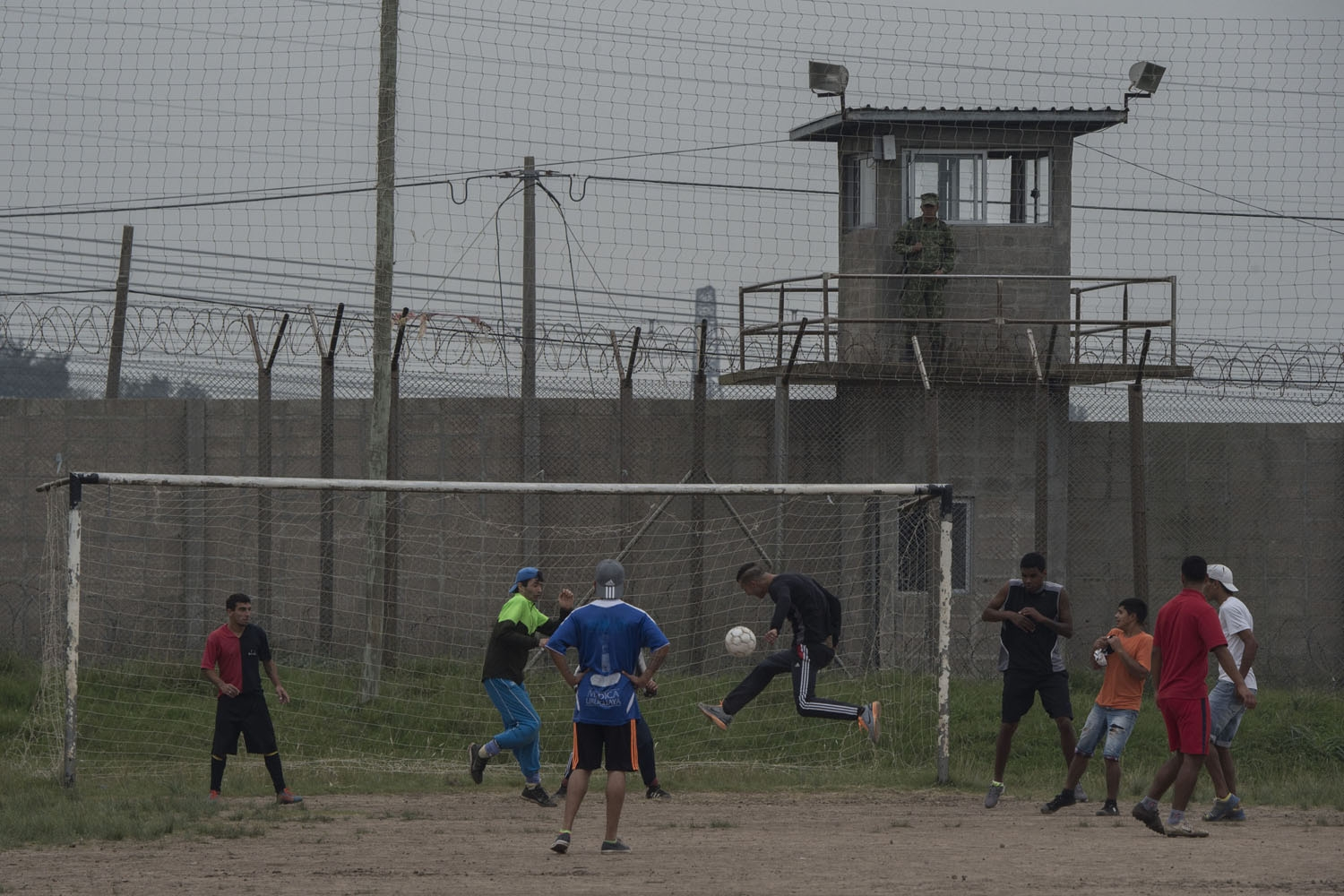 Inmates play soccer at the Punta de Rieles prison in Montevideo on May 05, 2016