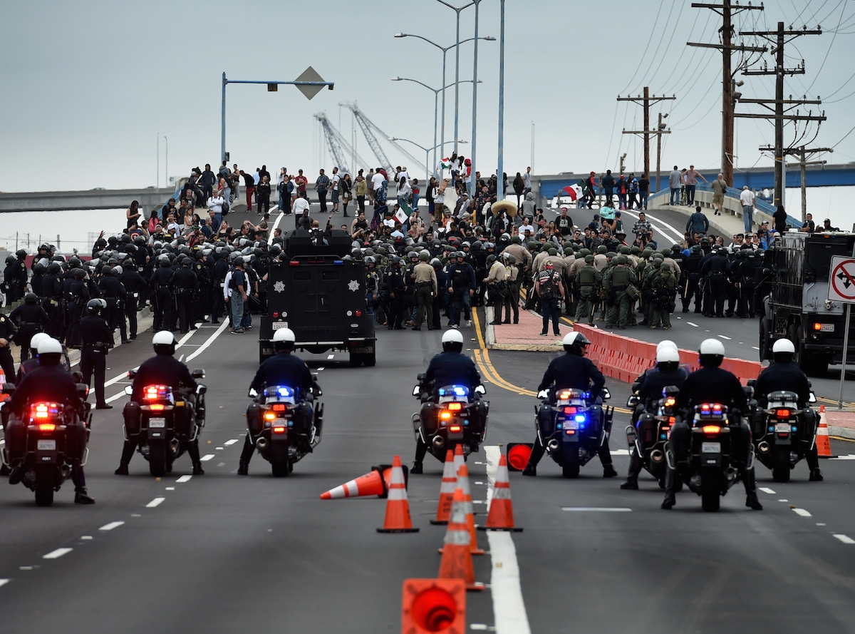 Anti-Trump protesters are moved away from the Convention Center after a rally outside Republican presidential candidate Donald Trump's event in San Diego, California, on May 27, 2016.   / AFP PHOTO / Mark Ralston