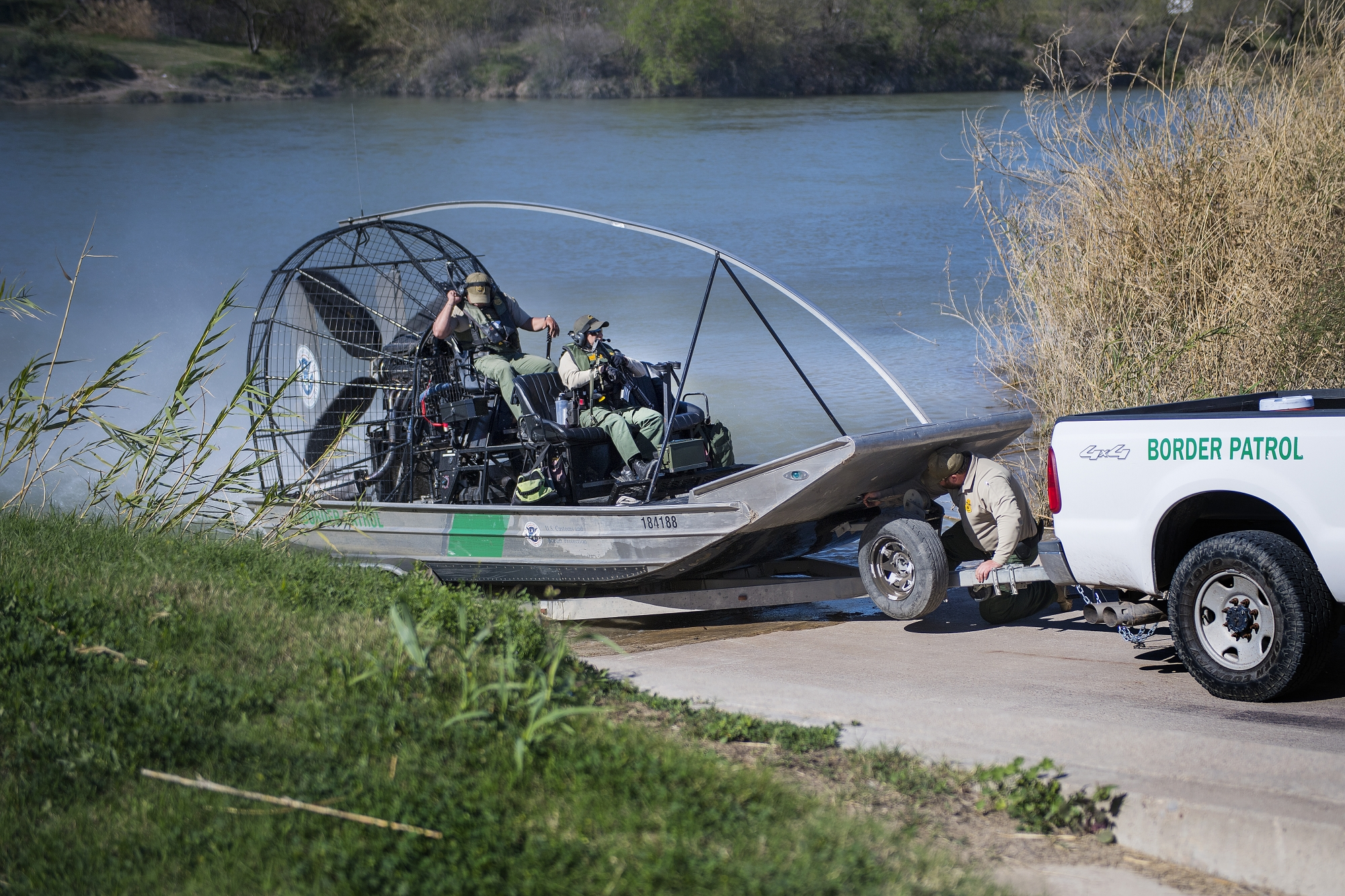 US Border Patrol pull outs of the Rio Grande river on a fan boat on the US/Mexico border in Eagle Pass, Texas, on February 21, 2017