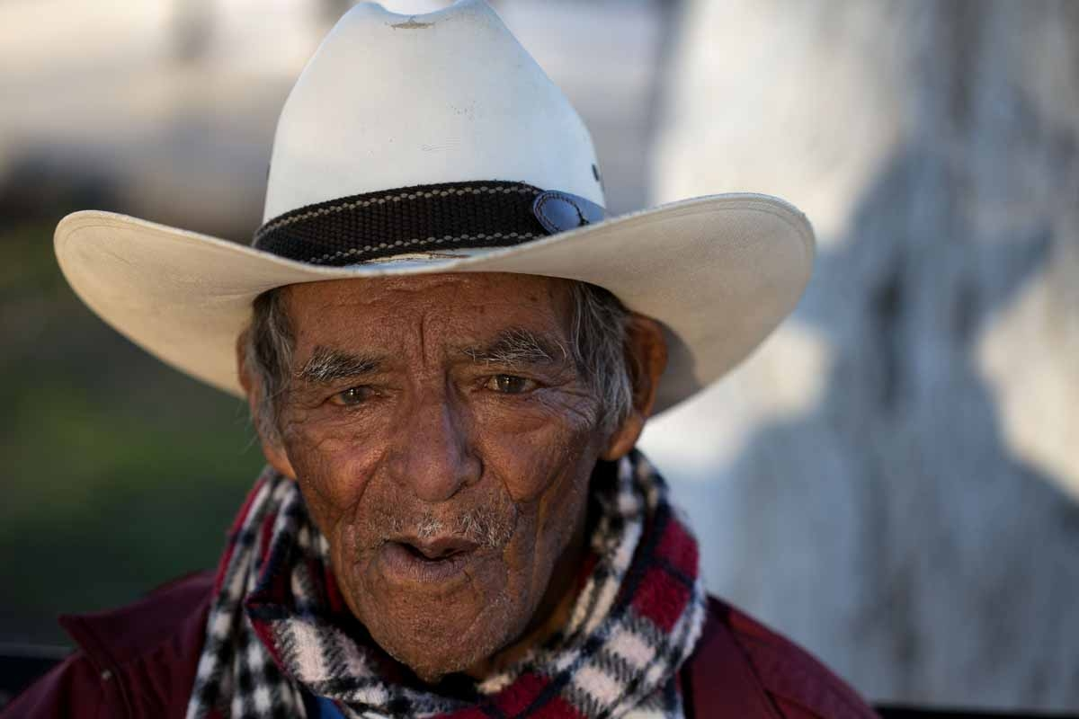 84 year old Trinidad sits at a plaza on the US/Mexico border in Piedras Negras on February  21, 2017 northern Mexico.