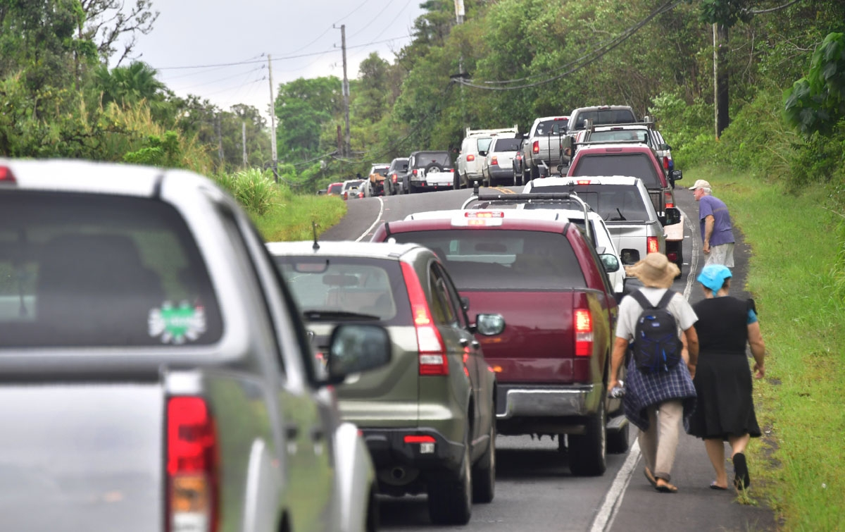 A convoy of vehicles of Leilani Estates residents waits to be let back into their homes to gather belongings on May 7, 2018. The residents were forced to evacuate a few days earlier because of Kilauea fissures.