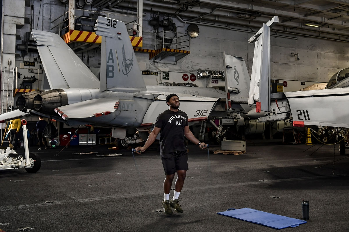 A member of the 330 meters aircraft carrier Harry S Truman works out under the deck of the warship on eastern Mediterranean Sea on May 8, 2018.