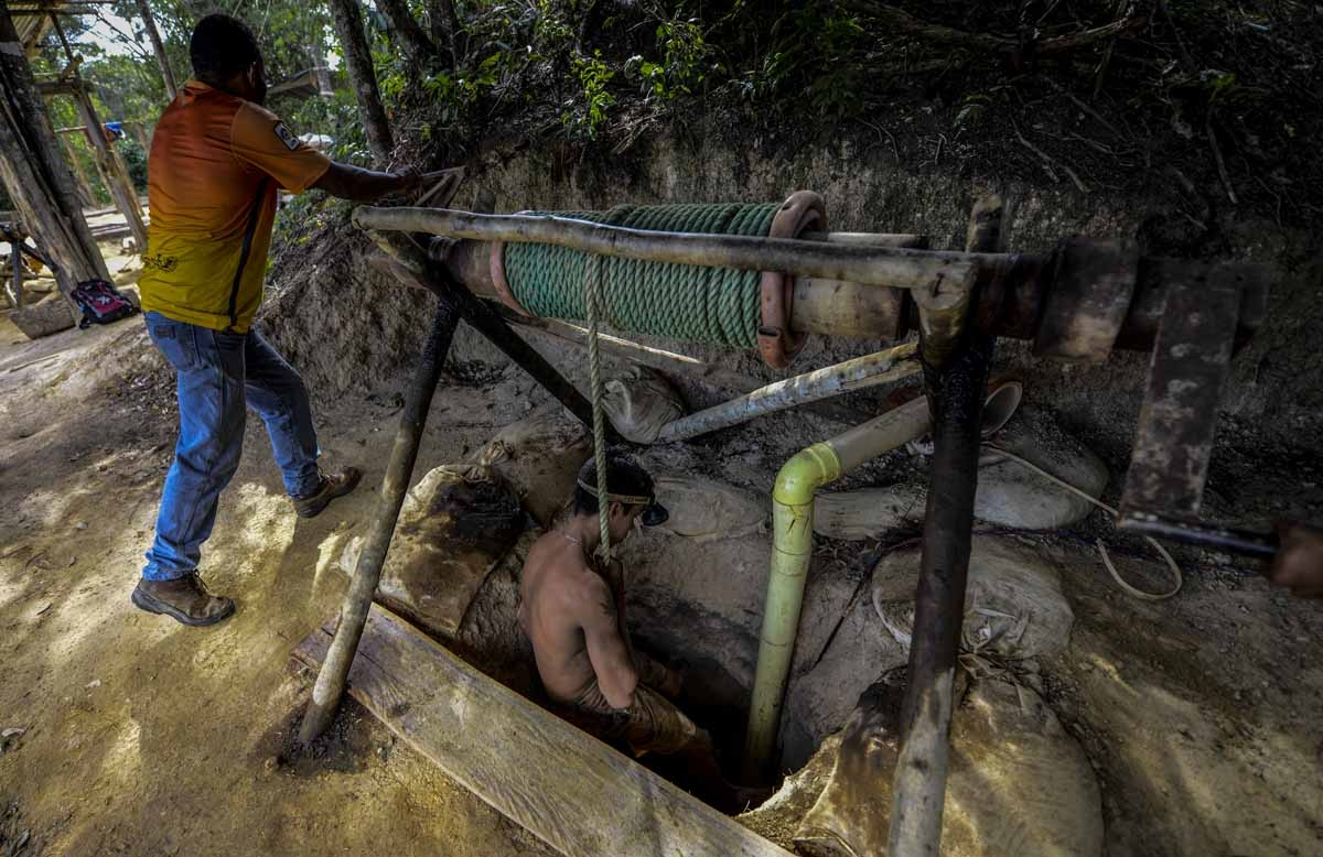 Ender Moreno descends into La Culebra underground gold mine in El Callao, Bolivar state, southeastern Venezuela on March 1, 2017. Although life in the mines of eastern Venezuela is hard and dangerous, tens of thousands from all over the country head for t