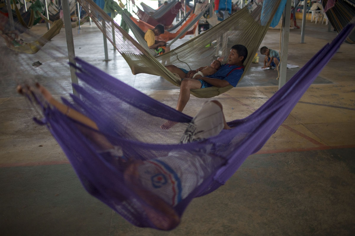 Venezuelan indigenous refugees rest on their hammocks, at the Pintolandia shelter in the city of Boa Vista, Roraima, Brazil, on February 24, 2018. When the Venezuelan migratory flow exploded in 2017 the city of Boa Vista, the capital of Roraima, 200 kilom