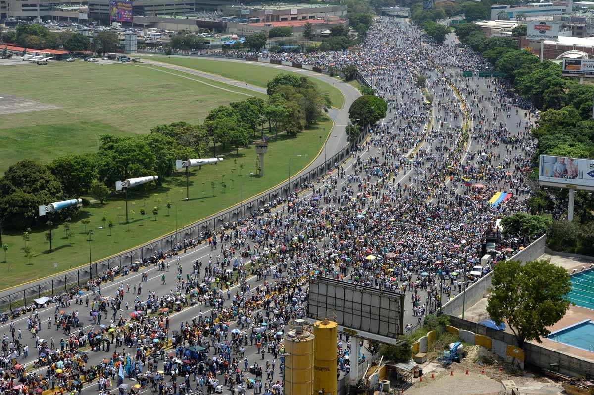 Thousands of Venezuelan opposition activists demonstrate against President Nicolas Maduro in Caracas, on April 24, 2017. Protesters rallied on Monday vowing to block Venezuela's main roads to raise pressure on Maduro after three weeks of deadly unrest tha