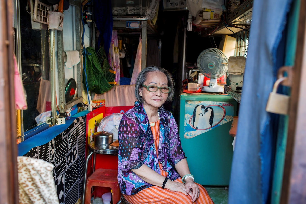 Nguyen Thi Tanh, 75, poses in her 6.7-square-meter home in Ho Chi Minh City on April 24, 2018.