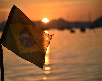 The Brazilian flag flys at sunrise on the  Botafojo beach in Rio de Janeiro during the 2014 FIFA World Cup football tournament on June 25, 2014.