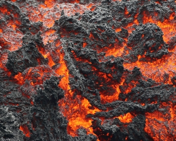 PAHOA, HI - MAY 12: Lava flows at a lava fissure in the aftermath of eruptions from the Kilauea volcano on Hawaii's Big Island, on May 12, 2018 in Pahoa, Hawaii. T