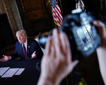 US President Donald Trump speaks to the press after talking to members of the military via teleconference from his Mar-a-Lago resort in Palm Beach, Florida, on Thanksgiving Day, November 22, 2018. (Photo by Mandel NGAN / AFP)